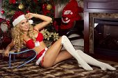 picture of christmas claus  - Sexy beautiful blonde woman posing in Santa Claus costume at home - JPG