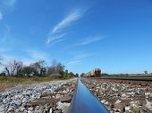 pic of wispy  - a view from the railroad track with blue sky and wispy clouds - JPG