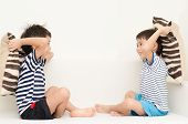 picture of pillow-fight  - Little sibling boy playing pillow fighting on sofa - JPG