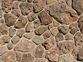 foto of scoria  - reddish brown vesicular basalt rock wall for background use - JPG