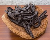 image of bean-pod  - Carob pods on cortical stand - JPG