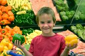 image of grocery-shopping  - boy with peppers in grocery store - JPG