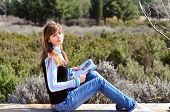 Teenager Girl Reading In The Park