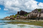 Enchanting Tourist Destination to Experience in Anse Source d'Argent with Huge Granite Rocks and Stunning Seascape, Located at Seychelles Islands. poster