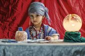 image of fortune-teller  - little child plays to be a fortune teller - JPG