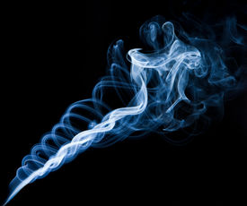 image of unicity  - twisting smoke spiral on black background horizontal shot - JPG
