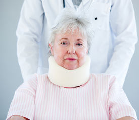 image of neck brace  - Portrait of a senior woman with a neck brace sitting on a wheelchair in a hospital - JPG