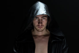 picture of madman  - Photo of the young man in hood on black background - JPG