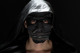 pic of madman  - Portrait of the madman in handmade mask on black background - JPG