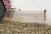 picture of spreader  - Liming action on the field in spring season  - JPG