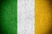 pic of irish flag  - flag of Ireland or Irish banner on rough pattern texture - JPG