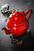 stock photo of teapot  - Tea composition with red teapot on dark background - JPG