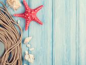 picture of shell-fishes  - Summer time sea vacation background with star fish and marine rope - JPG