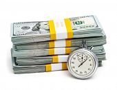 Постер, плакат: Time is money concept stopwatch and stack of new 100 US dollars 2013 edition banknotes bills bu