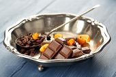 pic of orange peel  - Chocolate with orange peels and coffee beans in metal tray on wooden background - JPG