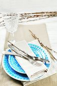 foto of pussy-willows  - Easter table setting with pussy willow branches on color wooden background - JPG