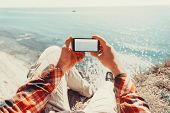 pic of pov  - Traveler man taking photographs sea with smartphone - JPG