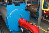 foto of boiler  - Gas copper with a  burner in a modern boiler - JPG