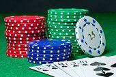 foto of flush  - Royal flush poker hand and chips on green felt table - JPG