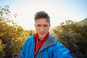 picture of blazer  - young  man make selfie on the morning mountains background - JPG
