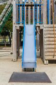 stock photo of playground  - Empty outdoor kid playground equipment at public playground - JPG