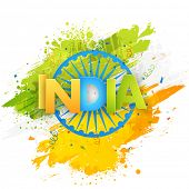 stock photo of indian independence day  - Shiny tricolor text India on Ashoka Wheel and national flag color splash background for Indian Independence Day celebration - JPG