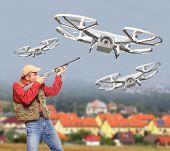 foto of shotgun  - Man with shotgun shooting down drone flying over his home - JPG