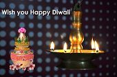 picture of swastik  - Holy pot image in traditional lamps surrounded for deepawali worship - JPG