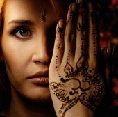 image of haldi  - Woman with traditional mehndi henna ornament  - JPG