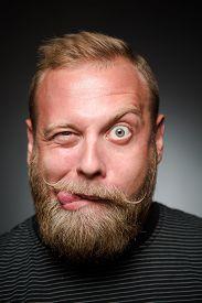 stock photo of fool  - Fooling bearded man in photostudio - JPG