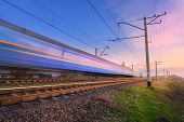High Speed Blue Passenger Train In Motion poster