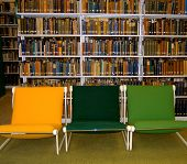 stock photo of midterm  - empty chairs in the stacks in a library - JPG