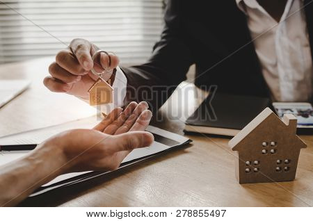 poster of Real Estate Broker Manager Giving House Key To Customer After Signing Contract For Buying House In E
