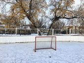 A Nice View Of A Large Outdoor Ice Hockey Rink In Edmonton, Alberta, Canada.  It Is Located In A Bea poster