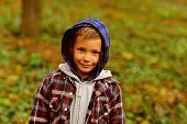 Enjoying Childhood Years. Small Boy Play Childhood Games Outdoor. Small Child On Natural Landscape.  poster