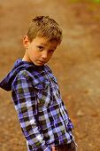 Trying To Look My Best. Little Boy With Adorable Look. Little Boy Wear Relaxed Outdoor Clothing. Its poster