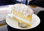 Cake Slice Cream Vanilla Cake Slice On White Plate - Coconut Cake Milk Dessert On Table In The Coffe poster