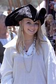 Young Pirate girl in a white blouse and Tricorn hat