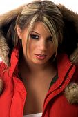 Head shot of a beautiful young girl in a red parka with a fur trimmed hood