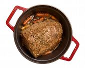 foto of pot roast  - Beef roast with baby carrots simmering in a red cast iron pot - JPG