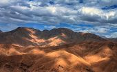 Amazing View Of Sandy Desert At High Atlas Mountains Range. Moroccan Landscapes With Bright Sun And  poster
