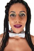 A Close Up Image Of A Young Woman Topless And Wearing A Silver Bow Tie With Black Braided Hair, Isol poster