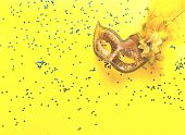 Carnival Mask On Yellow Background With Sparkles. Festive Backdrop For Projects. Flat Lay, Close Up. poster