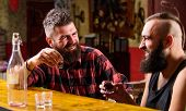 Hipster Brutal Bearded Man Spend Leisure With Friend At Bar Counter. Men Relaxing At Bar. Strong Alc poster
