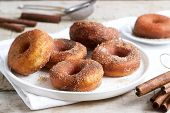 Homemade Donuts With Sugar And Cinnamon On A Wooden Background. Rustic Style. poster