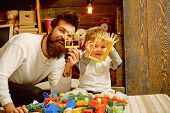 Friend Concept. Father And Child Play With Construction Toys, Friends. Father And Son Make Good Frie poster