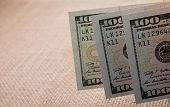 Banknotes Of Us Dollars On Canvas On A Linen Canvas poster
