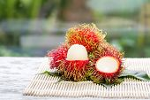 Rambutan Fruit On Trunk In The Garden,ripe And Green Rambutan Growing In Garden/colorful Red Fruit A poster