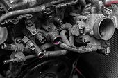 Close-up Of The Engine, Throttle, Raditor. Engine Breakdown: Pink Antifreeze Flows From The Pipes Of poster