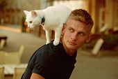 Curious Explorer. Happy Man On Walk With Cat Pet. Muscular Man Hold Cute Pedigree Cat. Happy Cat Own poster